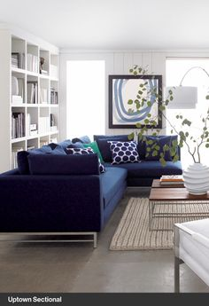 Love the idea of a navy sectional in the basement. Crate and Barrel Uptown Sectional
