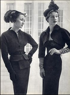 1949 Model in two-piece belted suit and Sophie Malgat (r) in slim dress topped with short bolero jacket, both by Balenciaga
