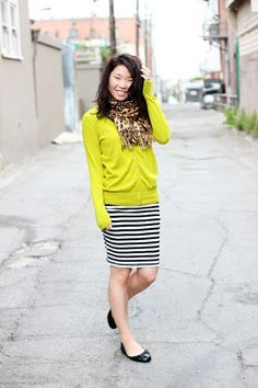 Love the neon and leopard print mixed with a striped skirt