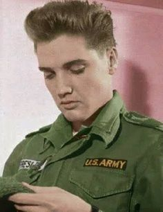 I wonder what Elvis is thinking, it's certainly not how good the stitching is on his hat