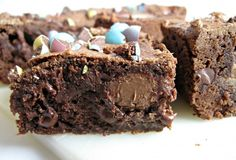 Cadbury Creme Egg Brownies- chewy brownies with Cadbury Eggs on the inside and chopped m&m's on top!| The Monday Box
