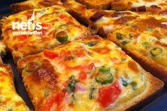Şimdi Çıktı Fırından       1 su bardağı ezilmiş rendelenmiş  beyaz peynir     1 su bardağı rende kaşar peyniri     1 adet yumurta     1 adet küçük domates( kabuğu ve çekirdeği çıkartılmış küp doğranmış)     2 adet ince doğranmış sivri biber     2-3 dal ince kıyılmış maydanoz     5- 6 adet kare tost ekmeği ( ince dilimlenmiş normal ekmekle de olur)     Oda ısısında yumuşamış tereyağ