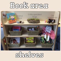 Book area shelves. Puppets for nursery rhymes on the top shelf. Props for There was an old woman and a selection of books in baskets.