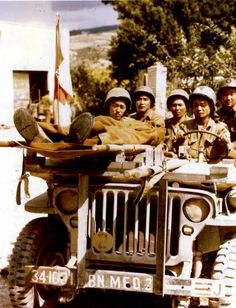 Medics of the 100th Infantry Battalion, composed of Japanese-Americans, use a jeep as an ambulance vehicle during fighting in Italy, mid-1940s. (Photo by PhotoQuest/Getty Images)