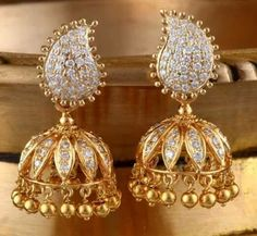 Explore our designer & Gold and Diamond Jhumka Earrings online with best price. Our one of a kind jhumka earring collection is handcrafted with Ruby, Emerald, Pearl & Diamond. Diamond Jhumkas, Gold Jhumka Earrings, Gold Earrings Designs, Wing Earrings, India Jewelry, Temple Jewellery, Indian Wedding Jewelry, Bridal Jewelry, Gold Jewelry