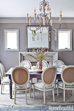 Sherwin-Williams's Backdrop, a muted gray color looks so relaxing for a dining room.