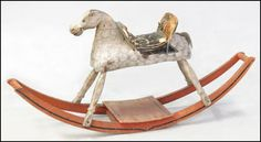 AMERICAN PAINTED WOOD ROCKING HORSE.