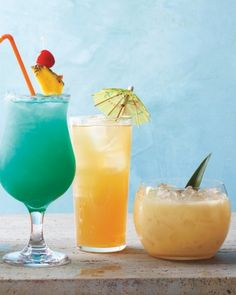 MMMMM - Tropical Summer Cocktail Recipes. (Pictured: Blue Hawaii; Mai Tai; Painkiller). Now for the party....