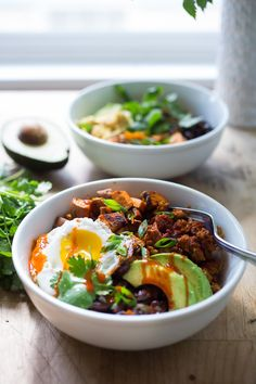 Healthy Yummy Breakfast Bowls with sweet potatoes, blackbeans, turkey chorizo ( optional) avocado, cilantro and an egg. | www.feastingathome.com