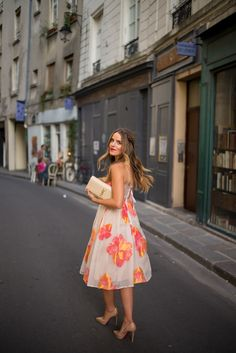 spring / summer - street style - street chic style - summer outfits - wedding outfits - party outfits - dresses - casual outfits - orange and pink floral dress + nude clutch + nude stilettos