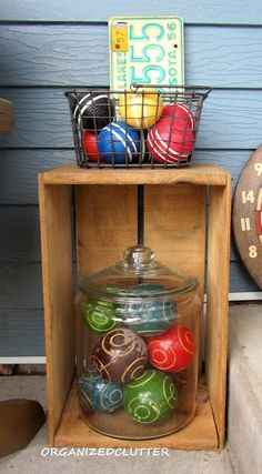 Don't throw out the croquet balls and bocce balls just because the set is bad.  Use them to decorate!