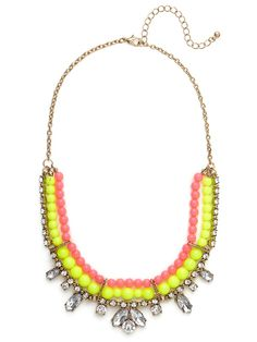 We love a good vintage-inspired crystal necklace.  But when you add brightly colored beading you get a look that's just a frivolously fun as it is beautiful.