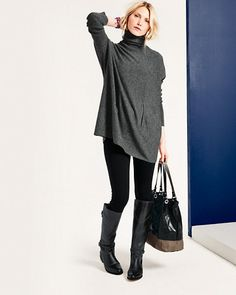 The generous cut and flattering tunic length of our Oversized Turtleneck Sweater looks fabulous anchored with slim pants or leggings and a sleek pair of boots.