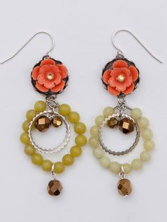 Spring simply bursts forth from these lovely coral resin flower earrings that sit atop silver-tone findings.  Jade beaded hoop, a silver-toned ring, and glass bronze beads dangle from the flower center.   Due to the handcrafted nature of this piece, slight color variations will occur. This is part of the charm of the item.