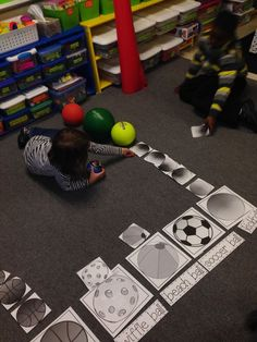 Here are a few more things we did with graphs this week. We used balls (my p.e. teacher bagged up a bunch of different ones for me) to create a real object graph. Then we moved the real objects to a p