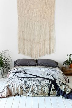 Idea: 2 hanging on either side of the couch!  -- Urban Outfitters - Magical Thinking Woven Fringe Wall Hanging