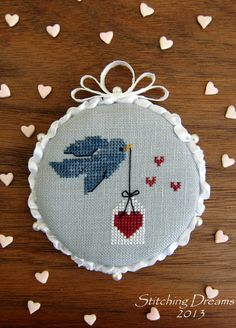 Cute free little valentine's cross stitch patterns like this bird with valentine!