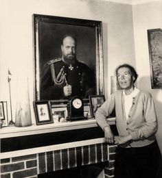 GD Olga in front of painting of her father Alex III - late 1950's ???