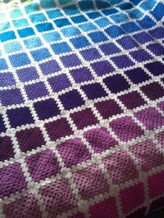 Crochet blanket of love - ombre-ish. I'd love to make the white filler pieces black and the purples and blues, browns and tans. A neutral, fall-ish blanket.