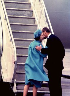 April 18, 1982: In a very rare show of public affection, husband Prince Phillip Duke of Edinburgh (Philip Mountbatten-born Prince Philip) (1921-living2013) Greece, gives a farewell kiss to Queen Elizabeth II (Elizabeth Alexandra Mary) (1926-living2013) UK in Ottawa, Canada as she prepared to fly home to the UK. Prince Philip later left for the U.S.A.