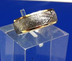 Meteorite wedding band, wide, lined in yellow gold, the perfect union of mysteries from the heavens with riches of the earth. Meteorite Wedding Band, Gibeon Meteorite, Custom Made Engagement Rings, Gents Ring, Ring Crafts, Heavens, Wedding Bands, Cuff Bracelets, Rings For Men