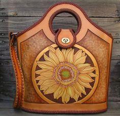 Beautifully hand-tooled designer bag by Black Dog Custom Leather