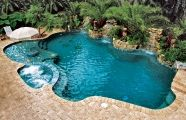 Love the waterfall and the shallow sitting area with umbrella! Needed in FL!