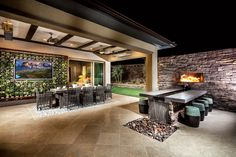 Impress your guests with this magnificent outdoor room coupled with exquisite stone elements and natural beauty from the Regency at Summerlin Summit model home in Las Vegas, Nev.