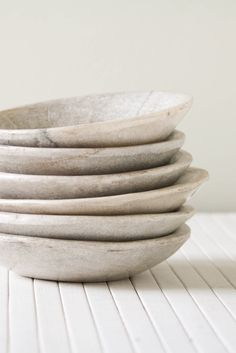 This limestone dish is a shallow bowl, quite solid, similar to concrete. I found this on shopolivemanna.com