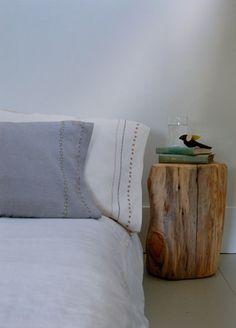 Bed with stump bedside table...for natural log side tables similar to this, try www.thelogbasket.co.uk