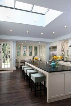 Skylight and recessed lighting with openness, see kitchen picture 2 with darker cabinets and lg windows