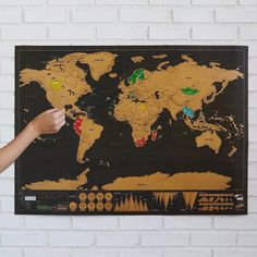 In additional to topographical markings of the world's mountains and oceanic ridges, this map has scratch-off foil pain to mark the places you have visited.