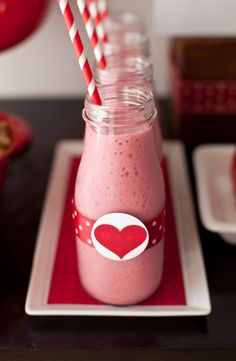 Healthy Valentine's Day Treat: Fruit smoothies! Throw fruit, yogurt, OJ & ice in the blender and puree. Serve out of decorated bottles to make it fancy. #valentinesday