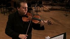 """Piotr Szewczyk: The Passion Behind the Music  Jacksonville Symphony Orchestra Violinist and Composer Piotr Szewczyk shares the passion and inspiration behind his music and the creation of """"First Coast Fanfare"""" in this documentary film."""