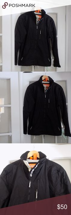 """Men's Superdry Windhiker Black Jacket Medium Large This awesome WindHiker from Superdry was only worn a few times and in great condition. The only part that shows very little wear is the inside lining.  The size of this coat is a Large but it fits more to a Men's Medium.  My husband usually wears a small or medium and it was just the right size with not much wiggle room. Measurements: 21"""" from underarm to underarm 27"""" from back neckline to bottom hem.  Materials: Outer is 100% nylon Lining…"""