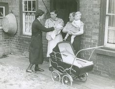 No mod cons: A tin bath and sturdy no-nonsense pram as the nurse does her rounds during the 1950's.
