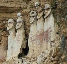 Cloud People of Peru -- the sarcophagi are large statues painted white with red…