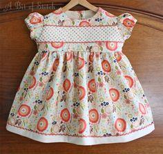Sweet and sassy! Sashiko machine cross stitching and flip stitched yarn on the bodice and hem. Riley Blake Designs fabrics. Rosie's Dress pattern hack to make a 3m size!