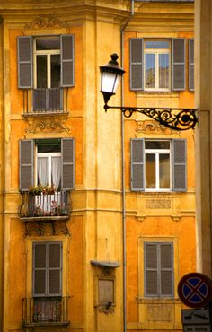Yellow, the Golden colour of #Rome.  Venetian Architecture with yellow walls, grey shutters and iron balconies.  #Mediterranean style architecture/