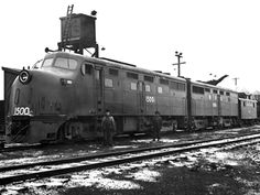 """(DL-202 & DL-203).  ALCO #1500c """"Black Maria"""" 1945.  A diesel-electric experimental freight locomotive.  One of an A-B-A set (2) DL-202 cab units & (1)  DL203 cabless unit.  ALCo demonstrators. Built 1945, scrapped 1947."""
