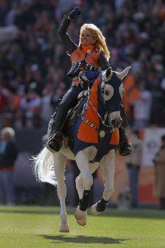 Ann Judge-Wegner and Thunder. Denver Broncos mascot.
