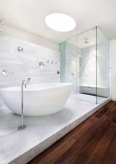 so elegant bathroom with carrara planked floors