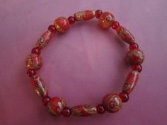 Red Wood and Glass Bead Bracelet by BeadazzlingButterfly on Etsy, $10.00