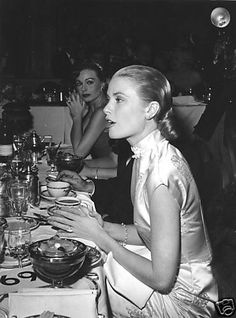 Ladies dining. Luxe fabrics, worn casually and without ultra adornment. posture and service at attention.