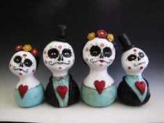 Day of the dead inspired work by the talented Amber Leilani Middleton.  Paper clay and acrylics