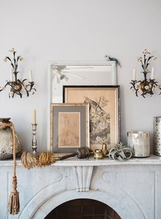 marble fireplace with mantel styled with vintage floral sconces, art, vessels and tassels. romantica sfgirlbybay / bohemian modern style from a san francisco girl Interior Styling, Interior Decorating, Interior Design, French Interior, Mantel Styling, Home Decoracion, Marble Fireplaces, Blog Deco, Fireplace Mantle