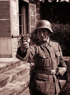 A German soldier poses with an eight-inch 9mm Artillery Luger