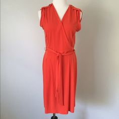 NWOT BANANA REPUBLIC Orange faux wrap Dress Beautiful orange dress with belt tie around waist. Gold buttons on shoulders. NEW without tags! Banana Republic Dresses
