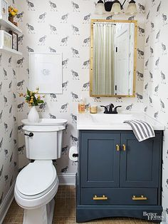 Remake a stock vanity with a coat of navy paint and gold hardware. When topped with a crisp white counter and oil-rubbed-bronze hardware, this modest small bathroom vanity looks much more expensive. Incorporate additional storage solutions to add function, such as a surface-mount medicine cabinet and shallow shelves.