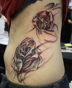 Rose tattoo on side of body